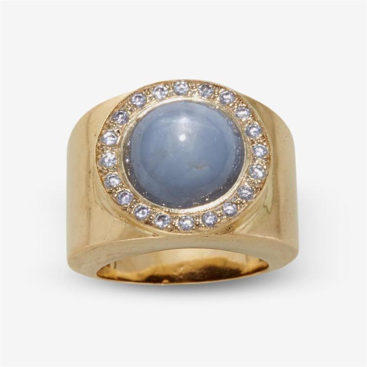 A lavender star sapphire, diamond and fourteen karat gold ring,