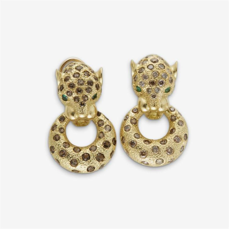 A pair of eighteen karat gold earrings,