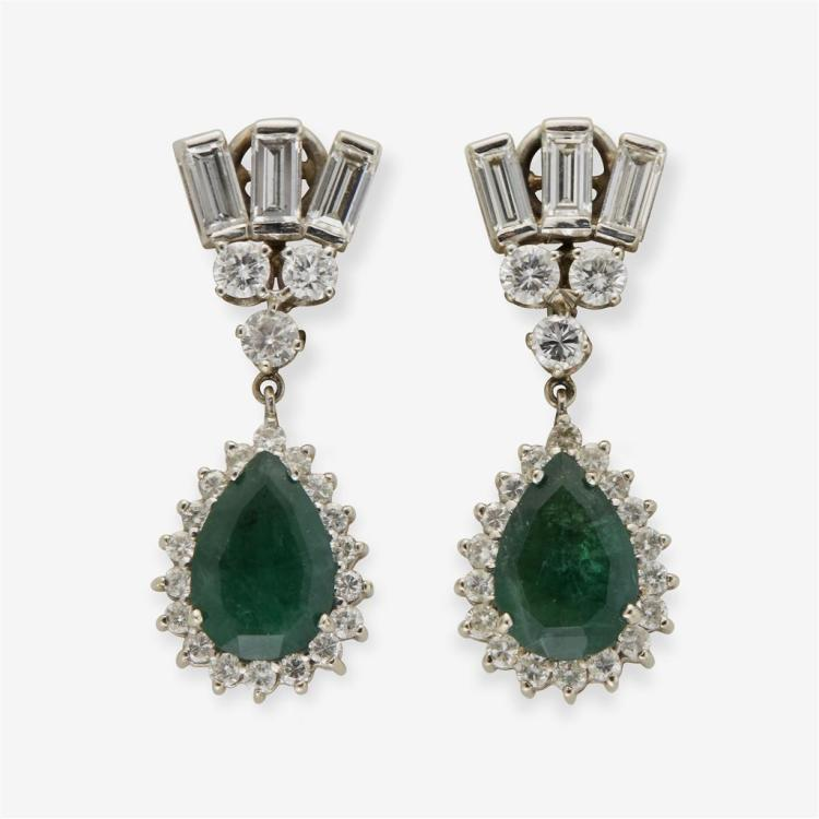 A pair of emerald, diamond and fourteen karat white gold earrings,