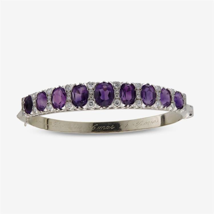 A diamond, gemset and fourteen karat gold ring and bracelet,