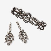 A pair of diamond and silver-topped gold earrings and brooch,