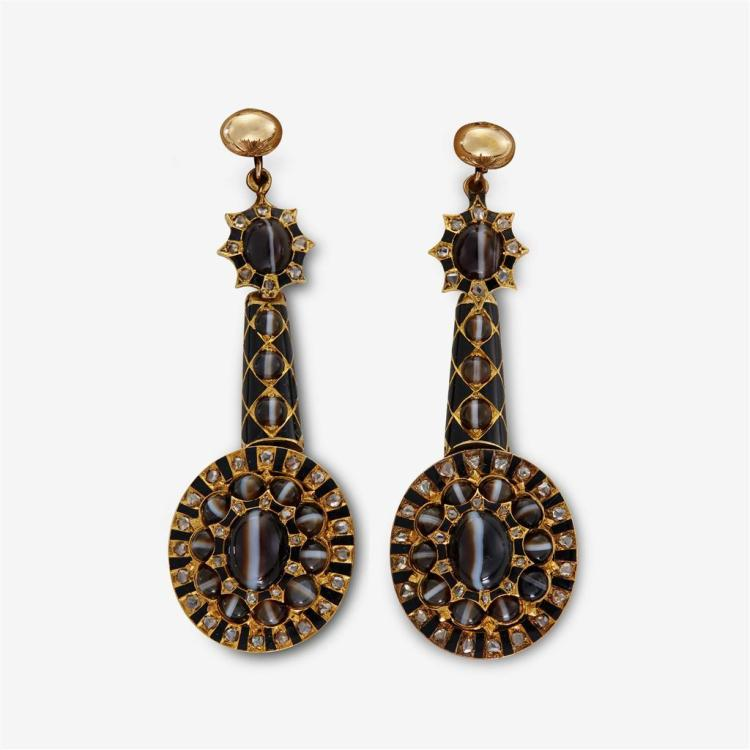 A pair of diamond, onyx and fourteen karat gold earrings,