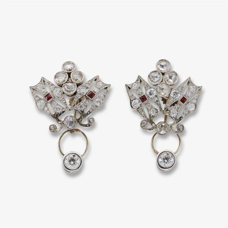 A pair of diamond synthetic ruby and white gold earrings with charms,