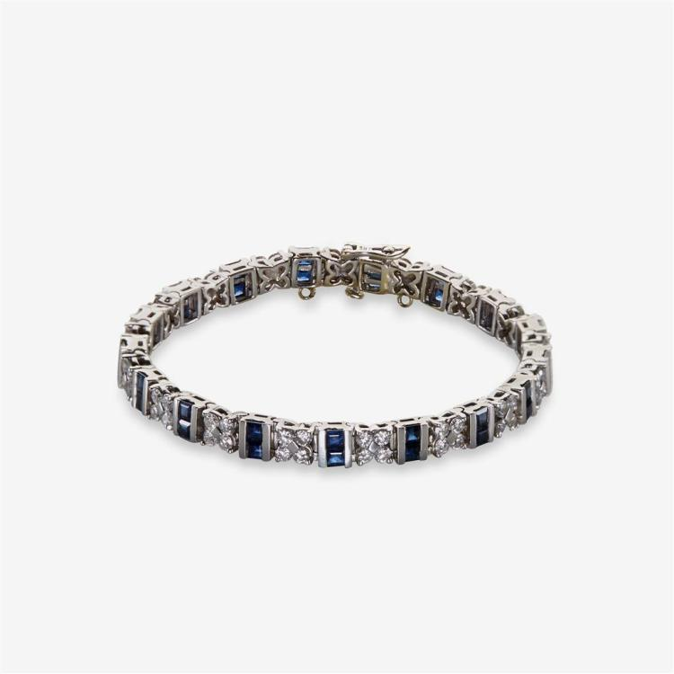 A diamond, synthetic sapphire and eighteen karat white gold bracelet,