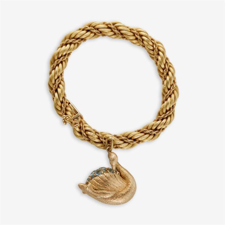 An eighteen karat gold bracelet and charm,