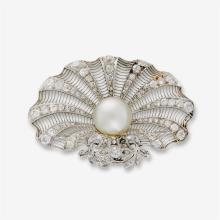 A diamond, cultured pearl and platinum brooch,
