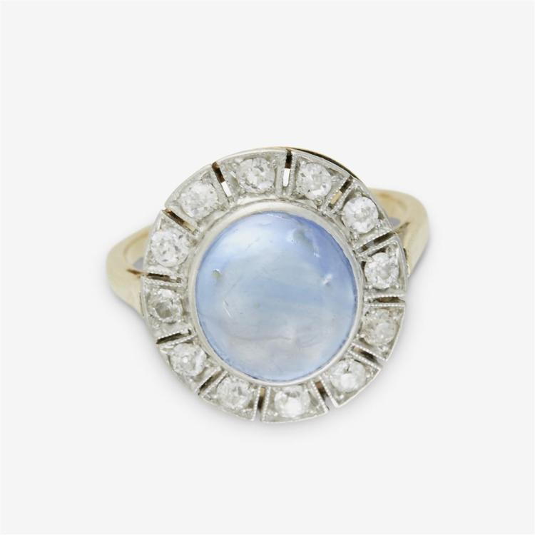 A sapphire cabochon, diamond and fourteen karat yellow gold ring,