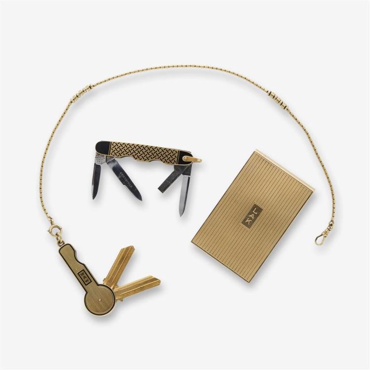 A Cartier fourteen karat gold pen knife with Cartier gold key with key case and a Cartier gold check holder,