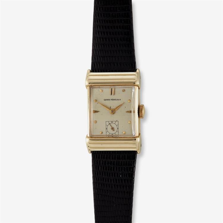 A fourteen karat gold strap wristwatch, Girard Perregaux,