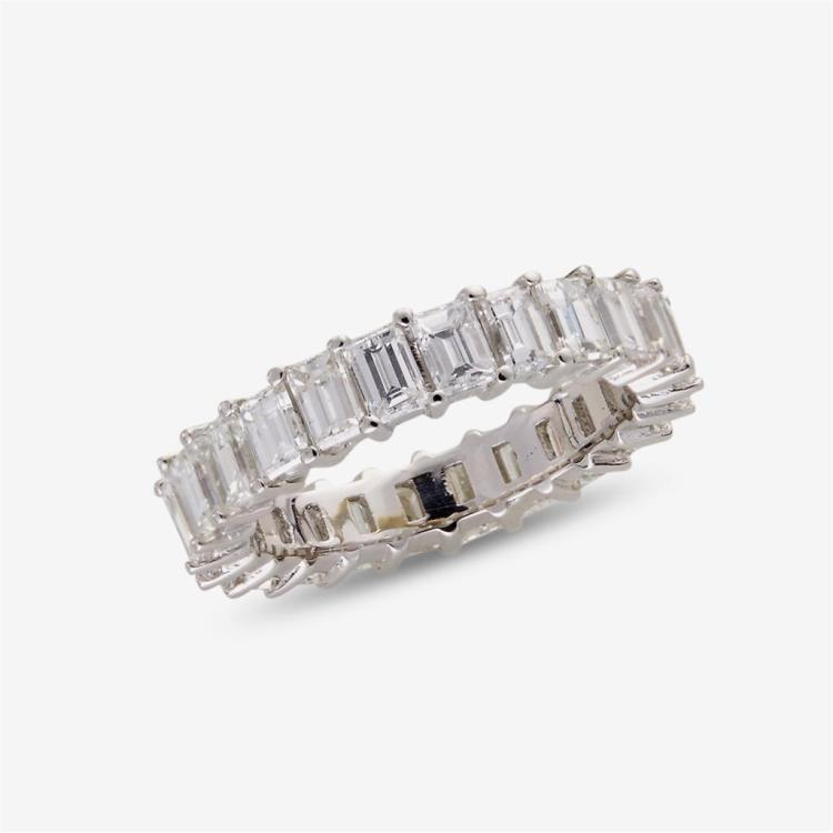 A diamond and eighteen karat white gold band,