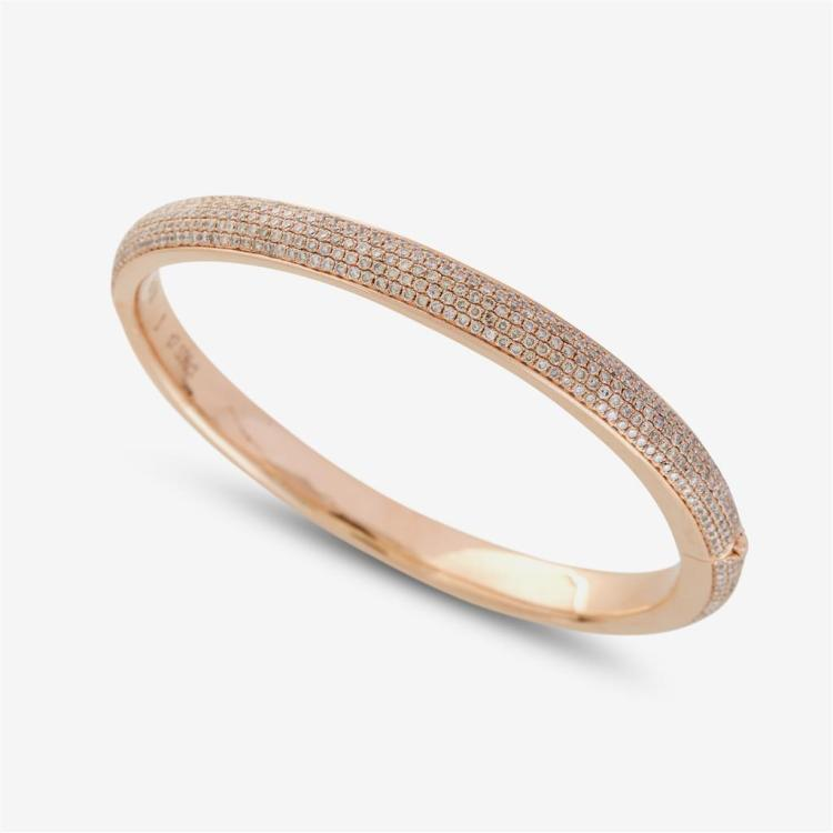 A diamond and eighteen karat rose gold bangle,