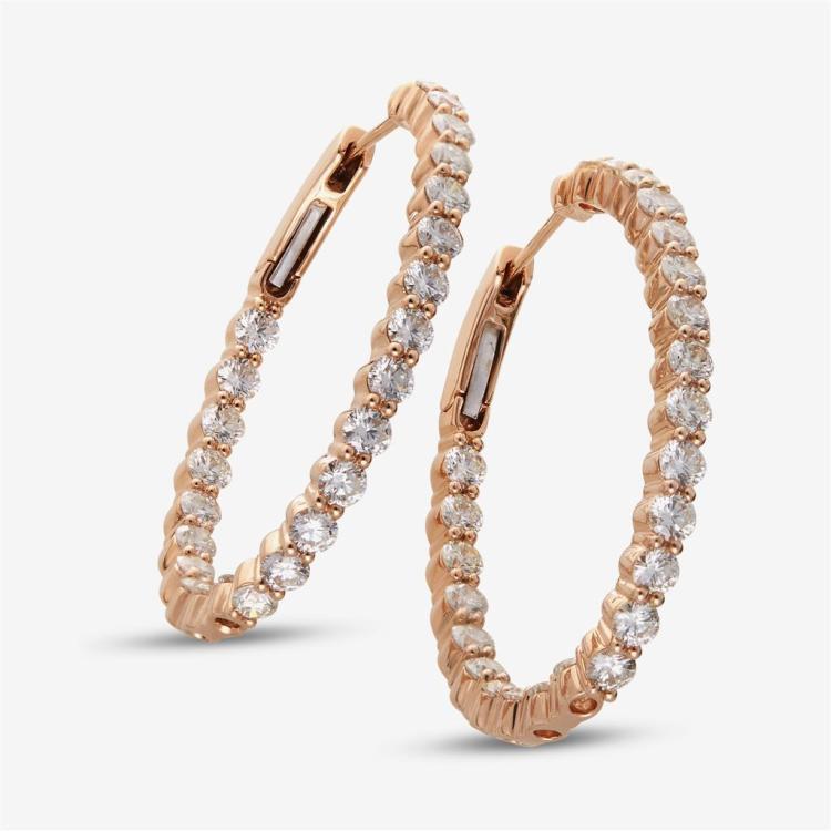 A pair of diamond and eighteen karat rose gold hoop earrings,
