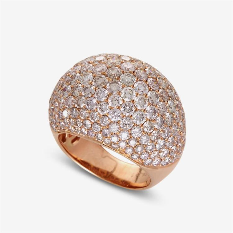 A diamond and eighteen karat rose gold dome ring,