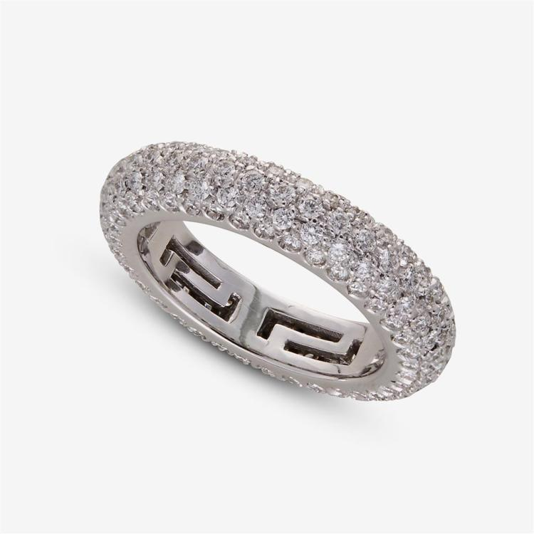 A diamond and eighteen karat white gold band, Bulgari band with box,