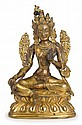 Sino-Tibetan gilt bronze bodhisattva, 18th century, Seated in lalitasana on a double lotus base, hands in vitarka- and varadamudras, be