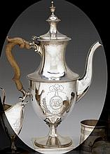 Large Federal silver teapot, circa 1800, Of urn form with beaded edges and shaped treen handle, all raised on a circular foot atop a sq