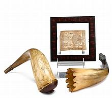 Powder horn, speaking horn, and framed Continental currency, 18th and 19th century, The first incised with figure of a woodsman fightin