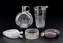 Five piece glass group, 19th and 20th century, Including a blown red flask, an uncolored double flask and shallow bowl all with white l