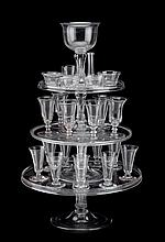 Rare tiered glass syllabub stand with glasses, england, late 18th century, Three graduated salvers surmounted by large top glass, each