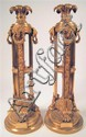 Pair of Empire style gilt metal candlesticks, , The acanthus cast nozzle above three lion's masks with rings in the jaws, issuing thre