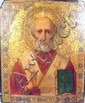 Russian painted panel icon of Saint Nicholas, early 20th century, Depicting the male saint with white beard and holding a bible, within