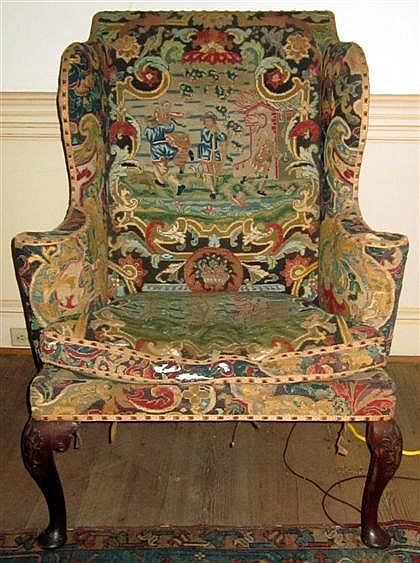George II style mahogany wingback armchair, 19th century, Upholstered in eighteenth-century needlepoint, on cabriole legs terminating i