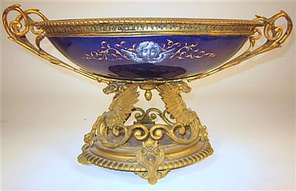 French Limoges gilt bronze and enamel centerpiece, late 19th century, The oval bowl painted to show a religious scene on a cobalt groun