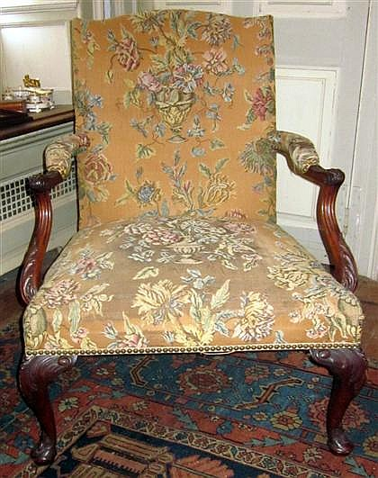 Pair of George III style mahogany library armchairs, 20th century, The needlework upholstered back and seat over padded arms flanking s
