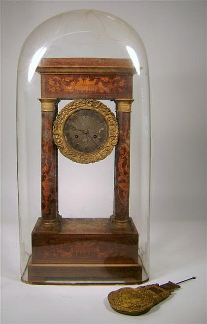 French marquetry inlaid gilt bronze mounted portico mantel clock, late 19th century, The circular silvered dial with Roman numerals, wi