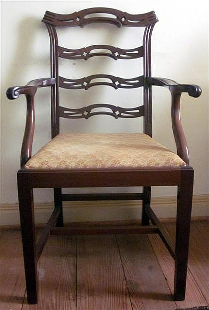 Ten George III style mahogany dining chairs, 20th century, Comprising eight side chairs and two armchairs, the ladder backs over drop-i