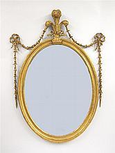 George III giltwood oval mirror, 18th century,