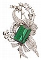 Platinum, tourmaline and diamond brooch, , Step cut green tourmaline approximately 9.80 carats, accented by petite round cut diamonds a