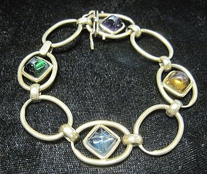 14 karat yellow gold and multi gem set bracelet, , Open oval polished gold links, displays sugarloaf cabochon green tourmaline, aquamar