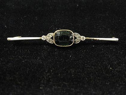 Yellow gold diamond, tourmaline and enamel bar pin, , Center green tourmaline accented by petite round cut diamonds and white enamel.