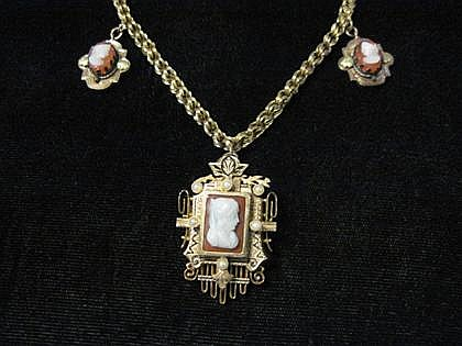 Yellow gold, cameo and black enamel pendant necklace, , Featuring a central cameo within a gold and black enamel frame, and two smaller