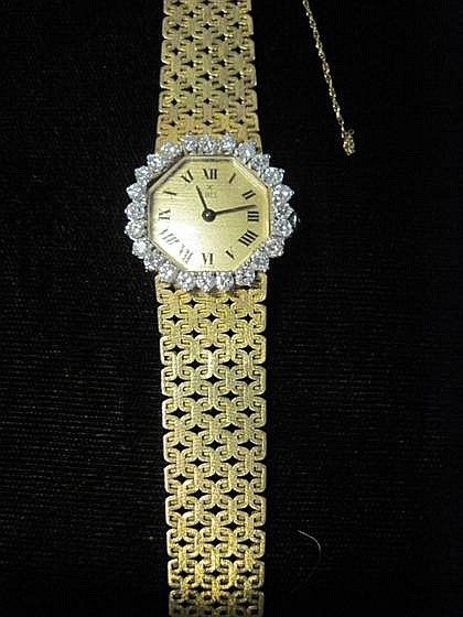 Lady's 18 karat yellow gold and diamond wristwatch, Ebel, , Octagonal case, brushed yellow gold face with Roman numeral dial, signed b