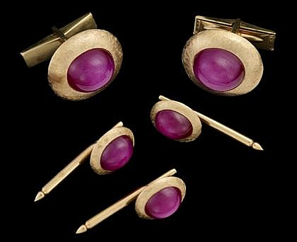 14 karat yellow gold and ruby dress set, J.E. Caldwell & Co., , Oval star ruby framed in florentine finish gold, accompanied by three s