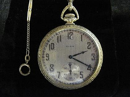 14 karat yellow gold filled pocket watch, Elgin, , Circular case, silver tone face with Arabic numeral and dash dial, signed by the mak