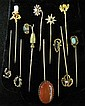 Group of eleven stick pins, , Of varying size, shape and theme.