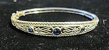 14 karat yellow gold and sapphire bangle, Kent & Woodland, , Detailed open work featuring three bezel set petite round cut sapphires, d