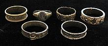 Group of six Victorian mourning rings, , 18 karat yellow gold inscribed band, displaying British hallmarks. 9 karat rose gold 'belt' ba