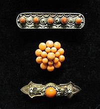 Group of three coral pins, , Bead cluster form pin. 10 karat yellow gold detailed bar pin featuring five cabochons. 14 karat yellow gol