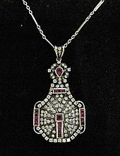 Silver-topped platinum, diamond and ruby pendant, , Featuring pear and calibre cut rubies, accented by petite round cut diamonds approx