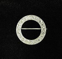 Platinum and diamond circle pin, , Featuring old European cut diamonds approximately 4.25 carat total weight.