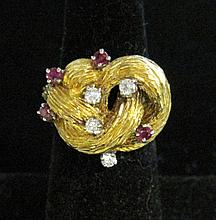 Lady's 18 karat yellow gold, diamond and ruby ring, , Textured gold 'knot' motif featuring petite round cut rubies and diamonds.