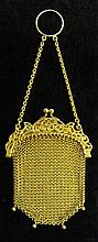 Lady's 14 karat yellow gold evening purse, , Detailed and fine gold mesh bag accented by petite gold beads, chain and finger ring.