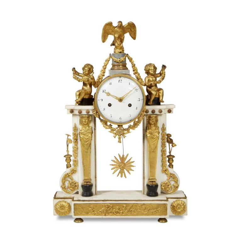 A Louis XVI style gilt bronze-mounted white marble clock, second quarter 19th century