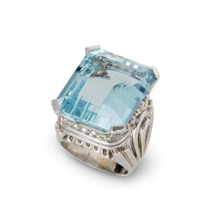 An aquamarine and fourteen karat white gold ring,