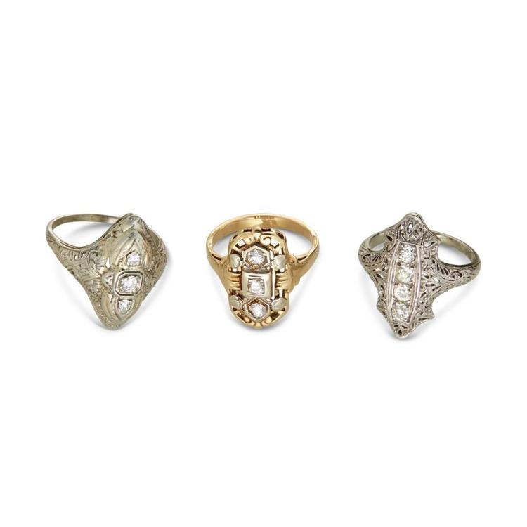 A collection of three diamond, eighteen and fourteen karat gold filigree rings, early twentieth century