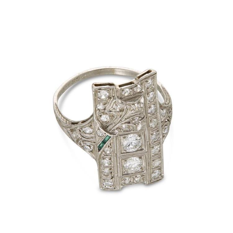 A diamond, green beryl and platinum ring,